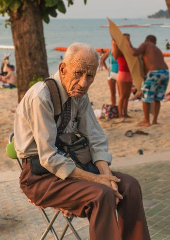 Life! Adult Outdoors Beach People Men Living Organism Adults Only Sitting Women Day Mammal Only Men One Person Close-up Old Elderly Elderly Man Life Aged Beauty Faces Of EyeEm EyeEm Best Shots Adult Portrait Pattaya Thailand Full Length Stories From The City This Is Aging