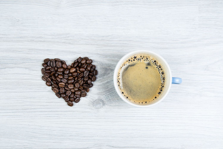 love coffee Beans Beverage Caffeine Coffee Background Coffee Beans Cup Enjoying Life Fresh Heart Roasted Top View White Background Wooden Texture Food Stories
