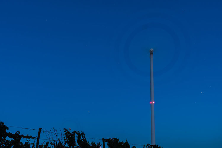 Circle Round Wind Turbine Turbine Alternative Energy Nightphotography Blue Clear Sky Copy Space Dusk Illuminated Lighting Equipment Long Exposure Low Angle View Nature Night No People Outdoors Pole Renewable Energy Sky Tall - High Technology Technology Photography Tower Windpower Windturbine