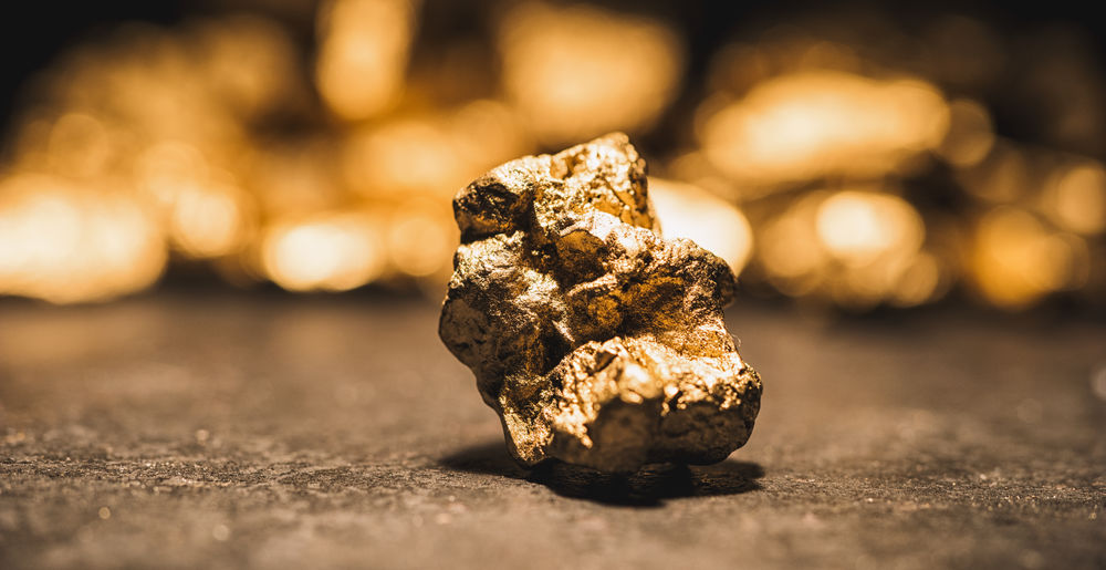 gold nugget in front of a heap of gold nuggets - Gold Hype concept image Business Confidence  Currency Gold GoldMine Golden Nugget Nuggets Shiny Assurance Banking Black Closeup Exchange Finance Finance And Industry Guaranty Heap Investment Jewelry Metal Mine Mineral Money Mount