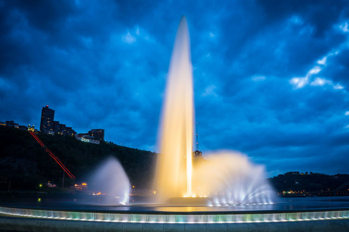 Architecture Blurred Motion Built Structure City Cloud - Sky Fountain History Illuminated Long Exposure Monument Motion Nature Night No People Outdoors Pittsburgh Point State Park Sky Skyscraper Spraying The Point Tourism Travel Travel Destinations Water