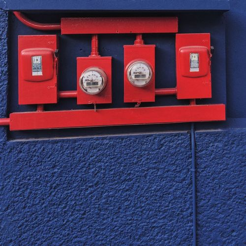 Red meters on wall