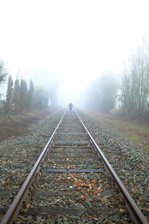 The Way Forward Direction Rail Transportation Railroad Track Track Diminishing Perspective Fog Tree Nature vanishing point Transportation Plant No People Autumn Day Sky Tranquility Outdoors Beauty In Nature Change Parallel Pebble Long