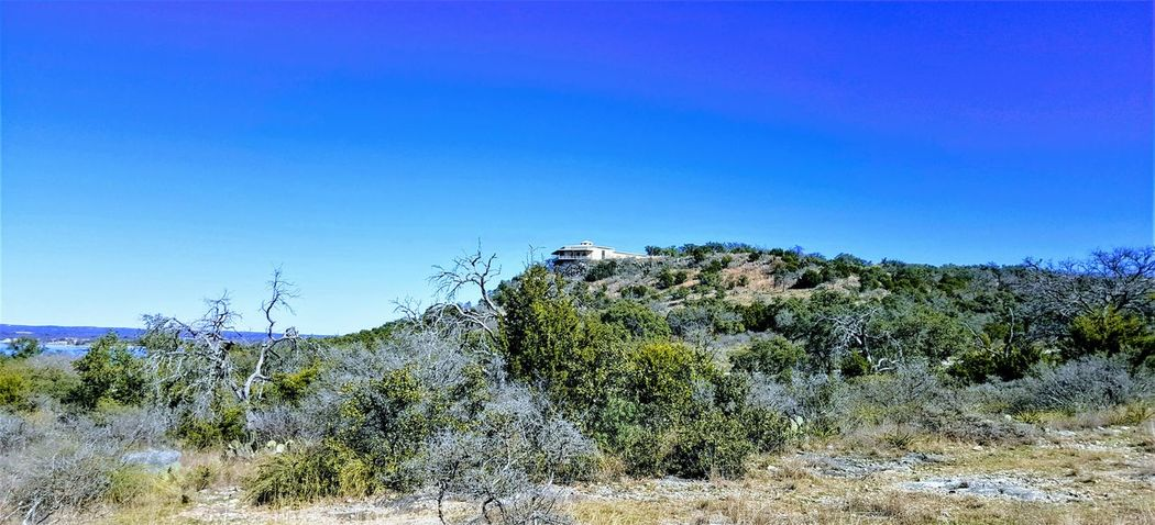 Wishing I Had Their View Blue Blue Sky Clear Sky Clear Sky Hills House On The Hill Lone House Nature No People Outdoors Scenics Sky Texas Hill Country Texas Landscape Texas Skies