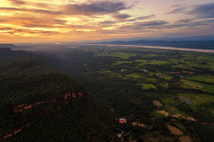Aerial view.Sunset Fields in the northeast of Thailand. Scenics - Nature Environment Landscape Sky Cloud - Sky Beauty In Nature Sunset Nature Tranquil Scene Aerial View Tranquility Land No People Non-urban Scene Idyllic Outdoors High Angle View Agriculture Horizon Field