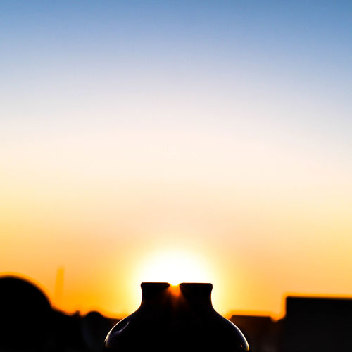 Silhouette Structures Against Clear Sky At Sunset