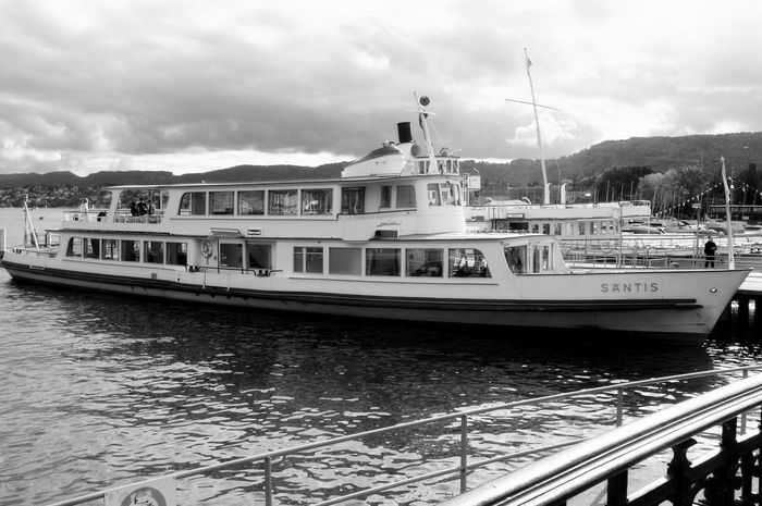 Black & White Harbor Nature Transportation Beauty In Nature Black And White Cloud - Sky Darkness And Light Fujifilm_xseries High Contrast Incidental People Lake Lake View Lake Zürich Mode Of Transport Monochrome Moored Motor Boat Nautical Vessel Outdoors Paddle Steamer Red Filter Travel Destinations Water Waterfront