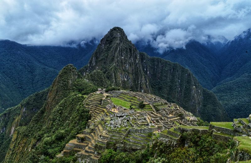 High angle view of ruins of mountain against cloudy sky