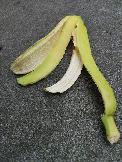 Banana peel On Ground EyeEm Gallery Eyeem Fruits Huawei P20 Pro Huawei P20 Pro Photography Urban Photography Yellow Fruit High Angle View Banana Close-up Food And Drink Banana Peel Raw Food Slippery Leftovers Still Life Peel Unripe
