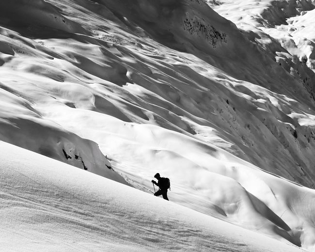 Inner Power This Is Masculinity Ascending Ascent Climbing Black And White Silhouette Alpine Ski Touring Splitboarding Snow Winter Cold Temperature Nature Scenics Weather Beauty In Nature Adventure Snowcapped Mountain Landscape Real People Tranquil Scene Leisure Activity Mountain Outdoors Frozen Tranquility Day Go Higher The Great Outdoors - 2018 EyeEm Awards This Is Strength