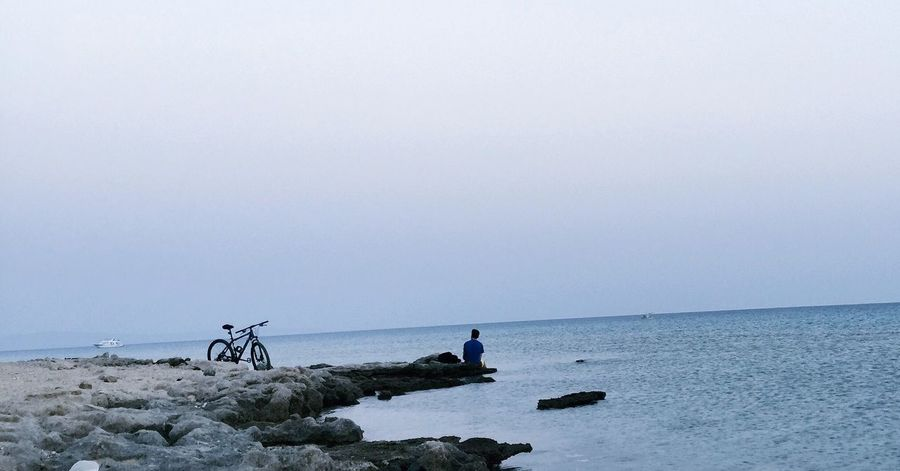 Sea Horizon Over Water Water Bicycle Copy Space Nature Beach Day Tranquility Scenics Tranquil Scene Beauty In Nature Transportation Outdoors Sky Clear Sky Real People Men People The Great Outdoors - 2017 EyeEm Awards EyeEm Selects