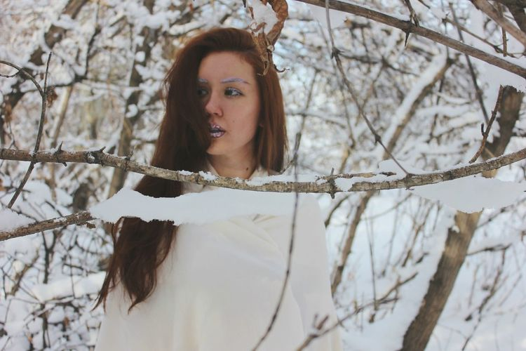 Tree White Color Young Adult Long Hair Tree Trunk One Person Branch Outdoors Snow Bare Tree One Young Woman Only Adult People Young Women Cold Temperature One Woman Only Beauty In Nature Adults Only Nature Day