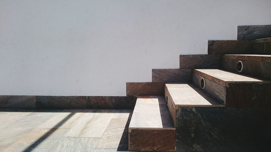 Wooden steps by wall