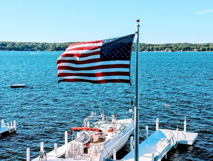 Blue Clear Sky Day Flag Freedom Independence Lake Geneva, Wisconsin Mode Of Transportation National Icon Nature Nautical Vessel No People Outdoors Patriotism Sea Sky Star Shape Striped Transportation Water Waving Wind