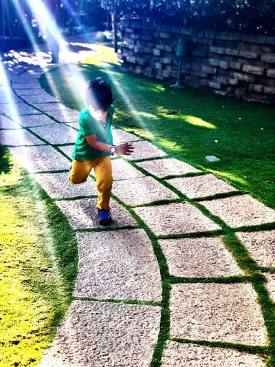 Real People One Person Full Length Day Outdoors Childhood Sunlight Grass Playing
