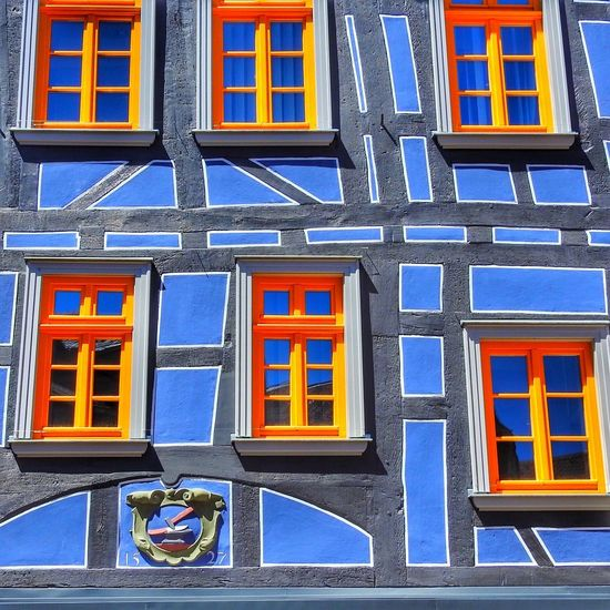 Blue facade with yellow coloured windows Wall Art Wall Façade Facade Building Yellow Building Exterior Architecture Window Built Structure No People Building Day Blue Outdoors Glass - Material Multi Colored City Low Angle View Sunlight Wall - Building Feature