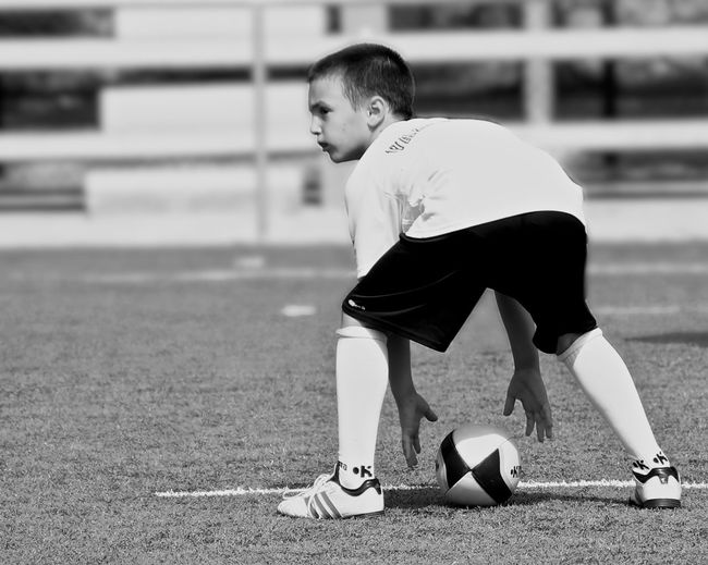 Boy Playing Rugby On Field