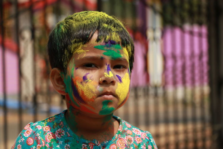 Holi: The festival of color. Multi Colored Holi Celebration Front View Face Paint One Person Focus On Foreground Fun Portrait FestivalOfColors Childhood Traditional Festival Powder Paint Child Day Outdoors Close-up