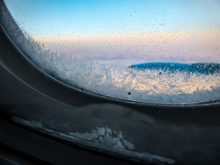 Aerial View Airplane Close-up Cold Temperature Flying Focus On Foreground Frozen Frozen Window Ice Ice Crystals Icy No People Plane Window Plane Window View Sharpness Transportation Window