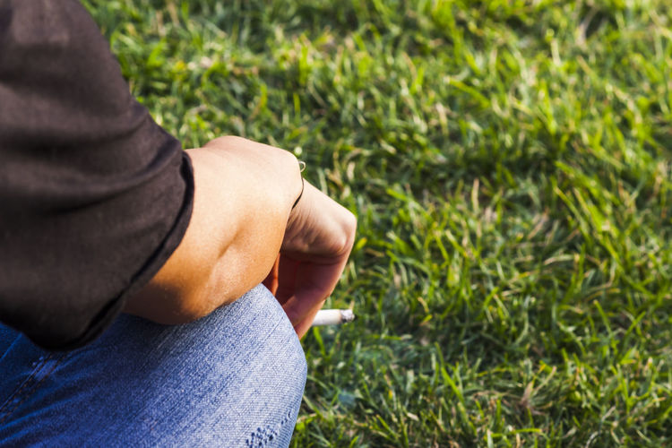 Smoking on the grass Alone Cancer Lonely Smoke Smoking Stress Addiction Arm Bad Cigarette  Fingers Habit Hand Healthy Eating Illness People Problem Psychology Sadness Society Wrong