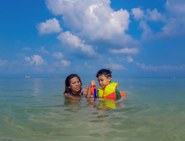 Woman and boy wearing a life jacket, scuba diving in the sea at Haad salad Beach , koh Phangan Suratthani Thailand. Water Sea Sky Cloud - Sky Leisure Activity Real People Two People Men Portrait Lifestyles Headshot Waterfront Beauty In Nature Togetherness Horizon Over Water Horizon Child Scenics - Nature Nature Outdoors Wave Scuba Diver Snorkeling Scuba Diving Surfer Water Sport Diving Suit Diving Equipment UnderSea Calm