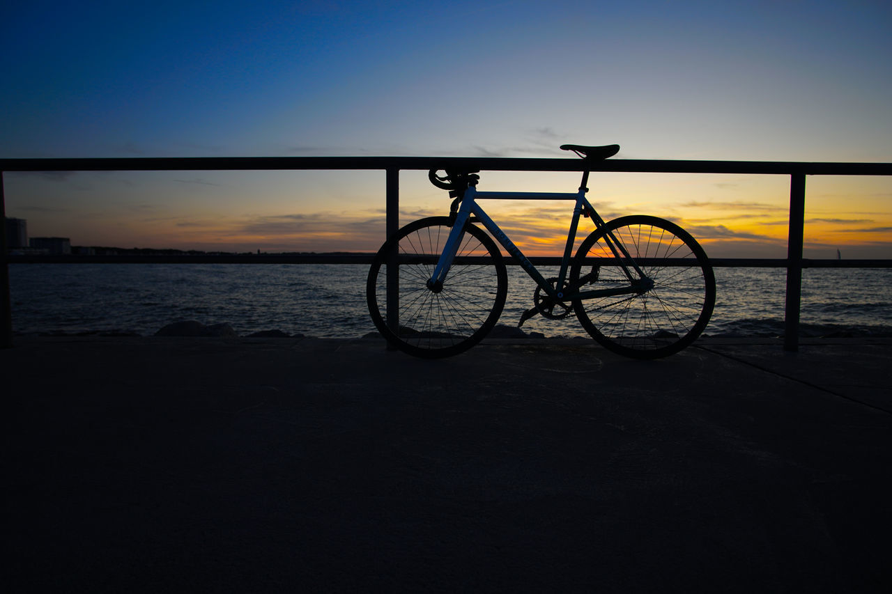 SILHOUETTE BICYCLE ON BEACH DURING SUNSET
