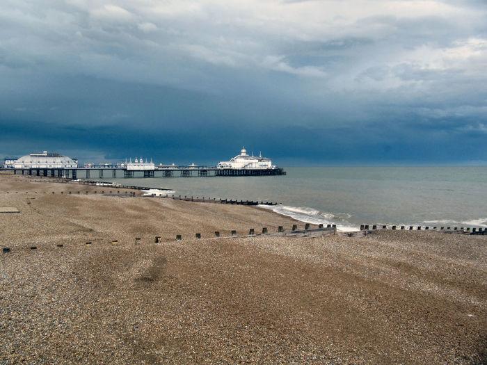 Eastbourne pier against cloudy sky