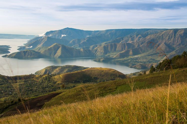 Toba Lake, Nort Sumatera EyeEmNewHere INDONESIA Toba Lake WeekOnEyeEm Beauty In Nature Day Grass Idyllic Landscape Mountain Mountain Range Nature No People Outdoors Physical Geography Scenics Sky Tranquil Scene Tranquility Water Perspectives On Nature