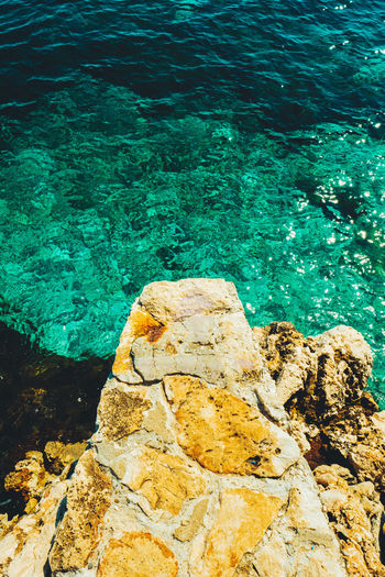 Beauty In Nature Blue Blue Sea Calm Clear Water Close-up Day Free Freedom Nature No People Outdoors Rock - Object Scenics Sea Springboard Stone Material Stones Stones & Water Textured  Water