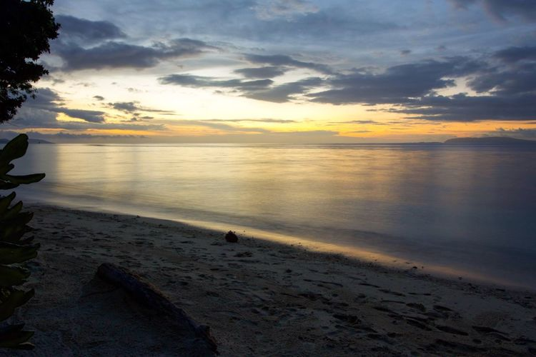 Sunset Sea Scenics Water Beauty In Nature Sky Tranquility Beach Tranquil Scene Horizon Over Water Nature Cloud - Sky Sand Idyllic Outdoors No People Exotic Tropical Raja Ampat Batanta Island Westpapua Day