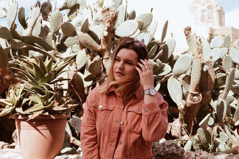Woman looking away against plants