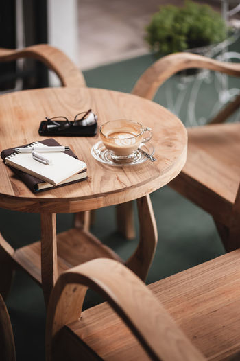 Empty coffee cup on table in cafe