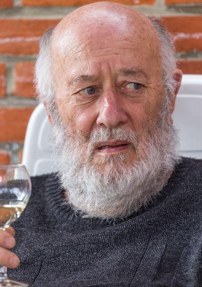 Portrait of man drinking glasses