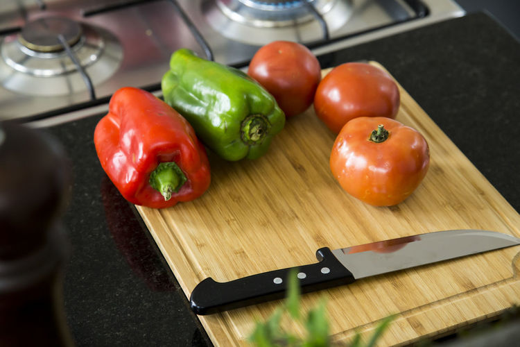 High Angle View Of Vegetable With Knife On Cutting Board
