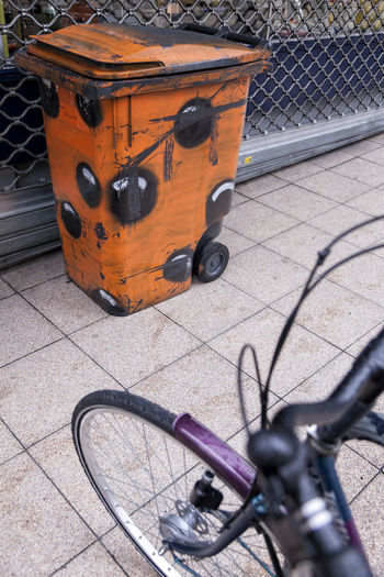 Street art 01 Bicycle Bike City City Street Container Day Diminishing Perspective Elevated View Graffiti Graffiti Art High Angle View Land Vehicle Mode Of Transport No People Orange Color Orange Container Outdoors Pavement Paving Blocks PLASTIC CONTAINER Purple Bicycle Street Streetart