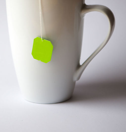 Close-up of mug with tea bag