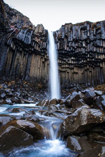 Svartifoss waterfall - Iceland Beauty In Nature Day Environment Iceland Long Exposure Motion Nature No People Organ Outdoors Portrait Rock - Object Scenics Sky Svartifoss Travel Destinations Water Waterfall
