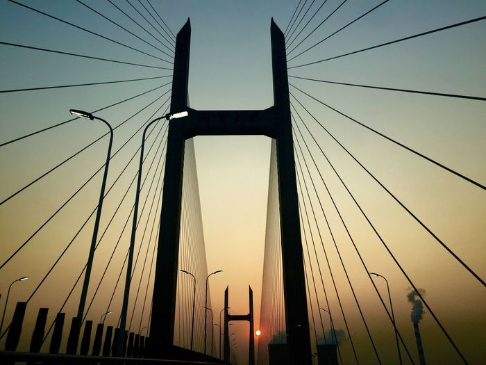 Sunset on the bridge Sunset Connection Low Angle View Sky Architecture Day Bridge Ihpone6 IPhoneography IPhone Photography Cable China Shanghai Smoke Pollution
