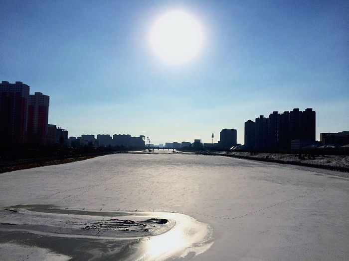 The River has Frozen . A quiet place in this city. Less people, more freedom. Frozen River Winter WHiTE WORLD Wintertime It's Cold Outside Suburban Winter_collection Sun