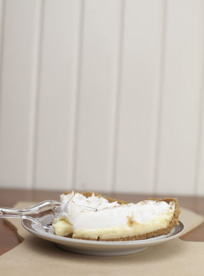 Two slices of lemon meringue pie on plate on a cut out of the state of Louisiana Food And Drink Kitchen Utensil Food Eating Utensil Plate Indoors  Ready-to-eat Freshness Table Spoon Still Life Sweet Food Close-up No People Indulgence Sweet Dessert Fork Unhealthy Eating Temptation Snack Sweets Hungry Baking Sweets Serving Pie Serving Size Fork Diabetes Diabetic Eating Healthy Unhealthy Food Lifestyles Unhealthy Lifestyles Healthy Lifestyles Sugar Sugary Sugary Food Lemon Flavor Lemon Pie Lemon Meringue Lemon Meringue Pie  Cooking Cooking At Home Heavy Carbs Eating Diet & Fitness Diet Yellow White