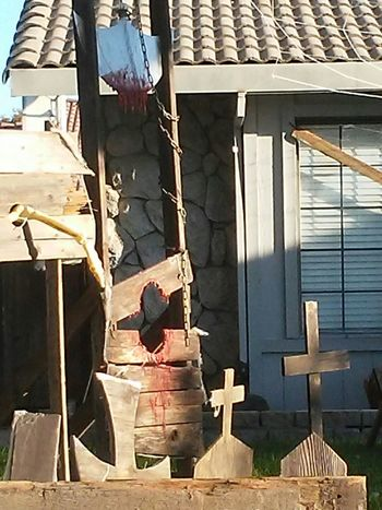 Wood - Material No People Outdoors Day Architecture Building Exterior Medevil Midevilstyle Decorate; Halloweenideas Holiday Season Yard Decorations Yard Art All Hollows Eve Halloween Decorations Torture Device Skeletal Remains Grass . giliteen blood