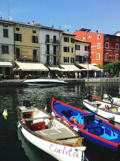 Nautical Vessel Canal Moored Transportation Water Mode Of Transport Travel Destinations Architecture Building Exterior Harbor Waterfront Gondola - Traditional Boat Business Finance And Industry Built Structure Rowboat Outdoors No People Day Sky Cityscape Lazise, Gardasee Italy Italian Landscapes The Way Forward Lake Silence