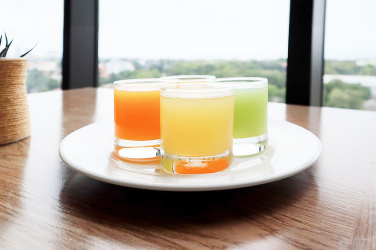 Breakfast Business Hotel Holiday Tourist Travel Carrot Juice In Glass Fruit Juice Guava Juice In Glass Healthy Eating Healthy Food Healthy Lifestyle Orange Juice In Glass Organic Resort Seletive Focus Summer Tropical Climate White Plate