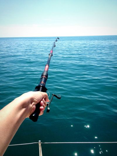 Close-up of hand holding fishing rod