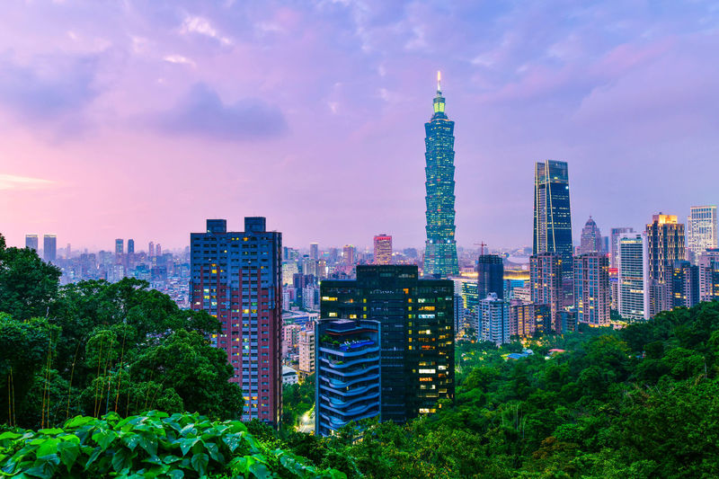 Taipei city skyline and downtown buildings with Taipei 101 skyscraper at Twilight time in Taiwan Building Exterior Architecture Built Structure City Building Office Building Exterior Skyscraper Cityscape Tall - High Sky Landscape Tower Modern Office Nature Travel Destinations Urban Skyline No People Financial District  Outdoors Spire  Taipei 101 Taipei Twilight 101