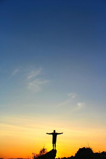 Low angle view of silhouette man against sky during sunset