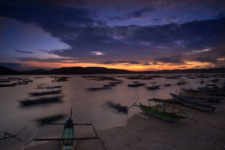 Sunrise at Gerupuk Beach, Lombok, Indonesia. Lombok-Indonesia Beach Beauty In Nature Boat Cloud - Sky Day Gerupukbeach Horizon Over Water Mode Of Transport Moored Nature Nautical Vessel No People Outdoors Outrigger Scenics Sea Sky Sunset Tranquility Transportation Water
