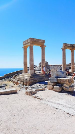 Sunny No People Desert Travel Destinations Ancient Architecture Day Outdoors Sky Sea Ancient Civilization Clear Sky Tranquil Scene History Landscape Mountain Horizon Over Water Rhodes Greece GREECE ♥♥ Lindos Greece Ancient Architecture Vacations Clear Sky Blue Nature