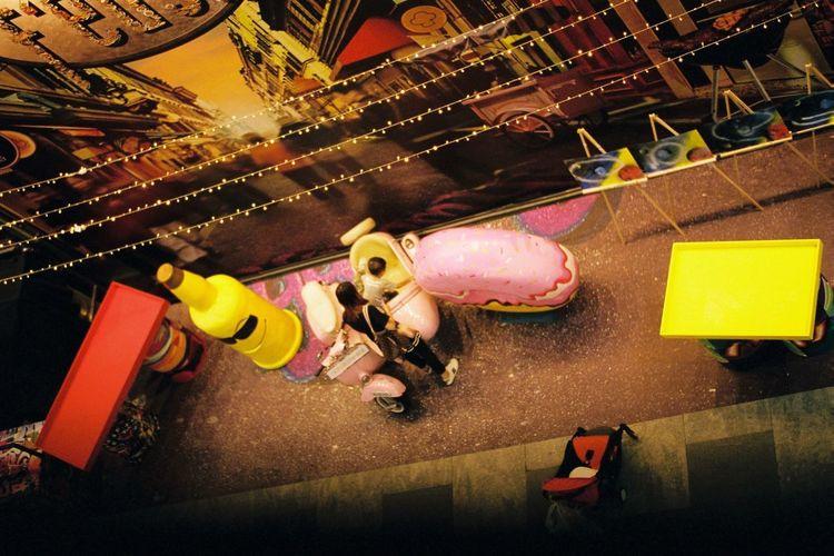 樂 Singaporestreetphotography Eyeem Singapore Singapore Streetphotography Filmisnotdead Moments High Angle View One Person Indoors  Tilt Toy Representation Celebration Decoration Women Real People Lifestyles
