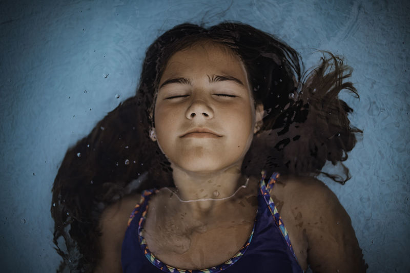 High angle view of girl floating on water